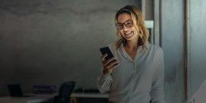 Woman checking account alerts