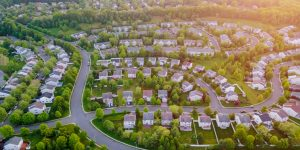 Top view aerial with from flying drone over residential district development buildings transportation
